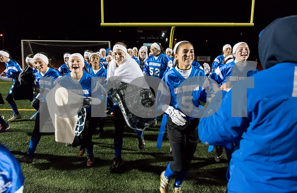 11/22/17 Wesley Bunnell | Staff Southington defeated New Britain in the annual Powder Puff game at Veterans Stadium in New Britain on Wednesday night. Southington players run to their side of the field following the victory.