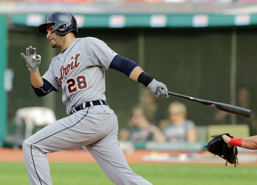 . Detroit Tigers\' J.D. Martinez hits a single off Cleveland Indians starting pitcher Corey Kluber in the first inning of a baseball game, Monday, Sept. 1, 2014, in Cleveland. (AP Photo/Tony Dejak)