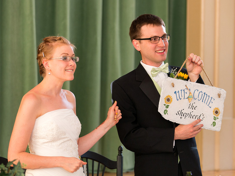 Bride and Groom with Welcome sign.jpg