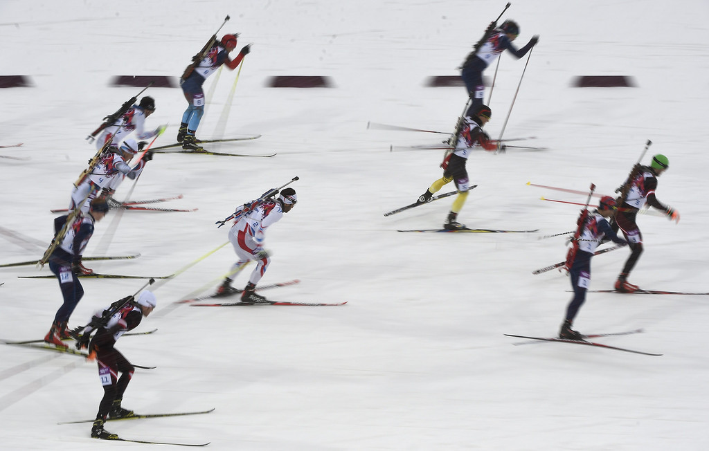 . France\'s Martin Fourcade  competes in the Men\'s Biathlon 15 km Mass Start at the Laura Cross-Country Ski and Biathlon Center during the Sochi Winter Olympics on February 18, 2014, in Rosa Khutor, near Sochi.  ODD ANDERSEN/AFP/Getty Images