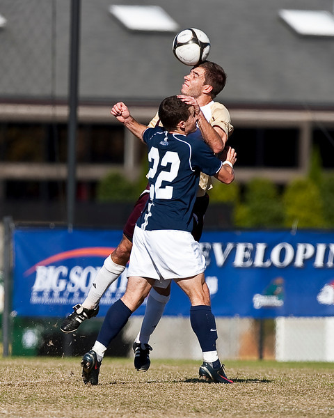 Matt Sckonicki (Winthrop) and Chris Osborne contest the ball in the finals match for the Big South Championship.