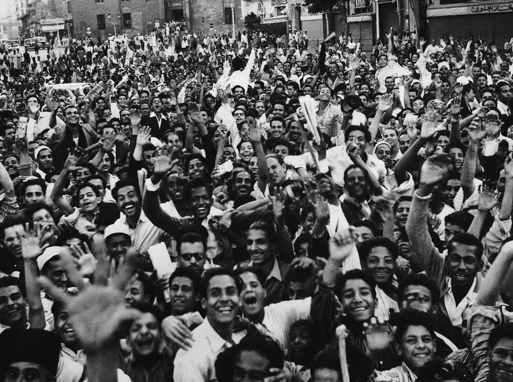 . A waving, shouting crowd demonstrates against Great Britain in Cairo on Oct. 23, 1951 as tension continued to mount in the dispute between Egypt and Britain over control of the Suez Canal and the Sudan. Police used tear gas to disperse Cairo mobs and fired into other crowds in Alexandria. (AP Photo)