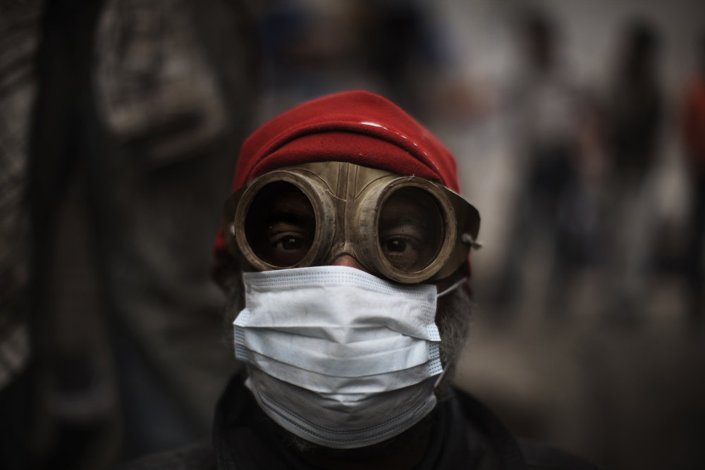 Description of . An Egyptian demonstrator uses goggles and a protective mask against tear gas fired by riot police during confrontations outside Cairo's security headquarters on February 6, 2012, as clashes continued in the Egyptian capital in the wake of deadly football violence and amid calls by activists for civil disobedience in Egypt.   MARCO LONGARI/AFP/Getty Images