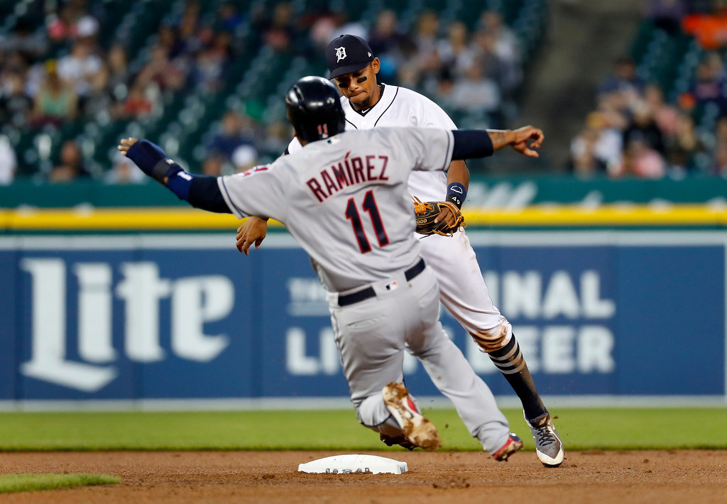 . Detroit Tigers shortstop Dixon Machado beats Cleveland Indians\' Jose Ramirez (11) to second base on a force out in the sixth inning of a baseball game in Detroit, Monday, May 14, 2018. (AP Photo/Paul Sancya)