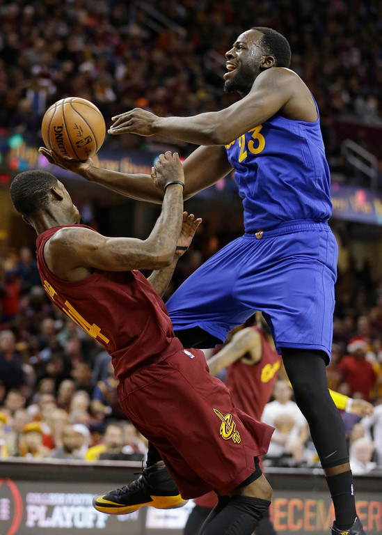 . Golden State Warriors\' Draymond Green (23) drives to the basket against Cleveland Cavaliers\' DeAndre Liggins (14) in the second half of an NBA basketball game, Sunday, Dec. 25, 2016, in Cleveland. The Cavaliers won 109-108. (AP Photo/Tony Dejak)