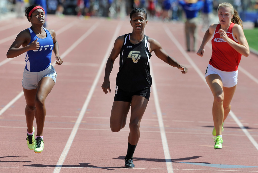. Imani Dixon from Golden Valley, center, speeds past Cilver City Kenia Bonill and Redondo Union Anevay Hiehle in the girls 400 meters during the 2013 CIF Southern Section Track & Field Divisional Finals held at Mt. San Antonio College in Walnut, CA 5/18/2013(John McCoy/LA Daily News)
