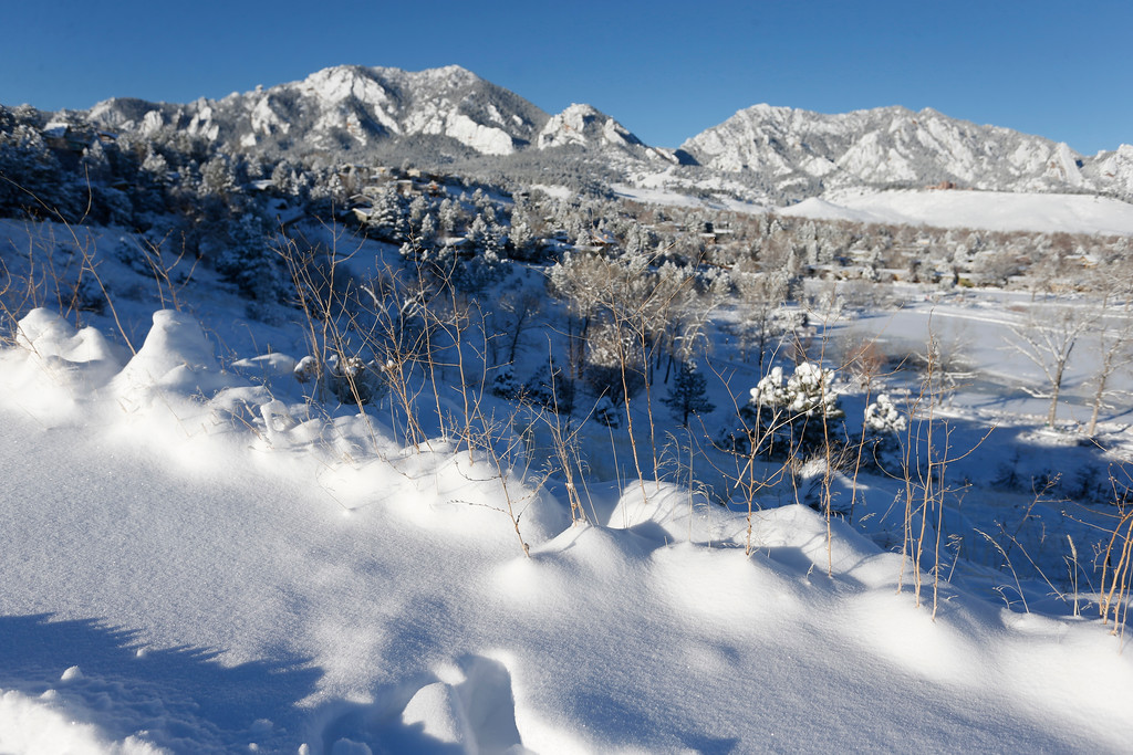 . Fresh snow covers the mountains overlooking Boulder, Colo., Friday, Jan. 6, 2017. A winter storm dropped several feet of snow in the Colorado high country, and over a foot in Front Range communities. (AP Photo/Brennan Linsley)