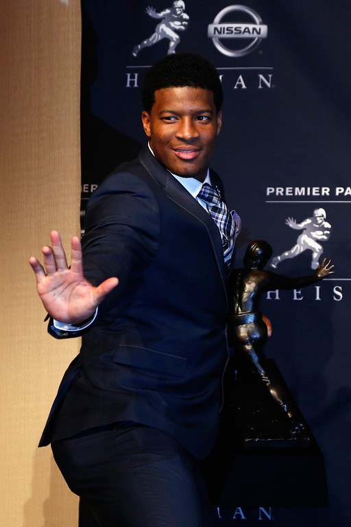 . Jameis Winston, quarterback of the Florida State Seminoles, poses with the trophy during a press conference after the 2013 Heisman Trophy Presentation at the Marriott Marquis on December 14, 2013 in New York City.  (Photo by Jeff Zelevansky/Getty Images)