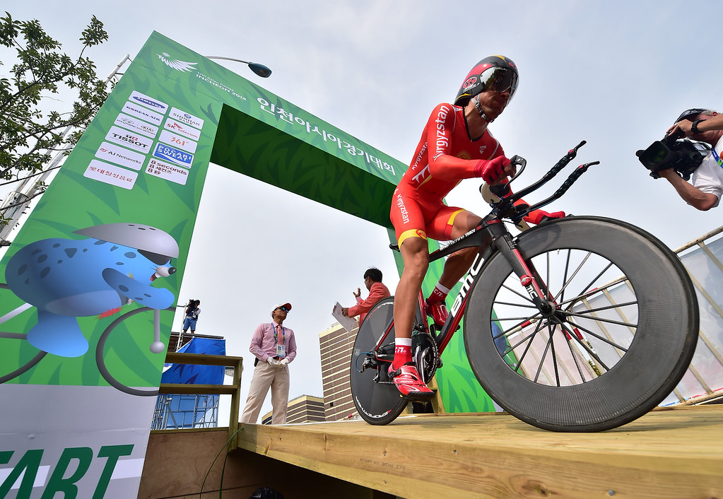 . Kyrgyzstan\'s Evgenii Vakker starts in the men\'s individual time trial road cycling event during the 2014 Asian Games in Incheon on September 27, 2014. JUNG YEON-JE/AFP/Getty Images