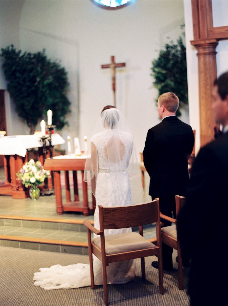 Bride and groom stand at their Catholic ceremony at the Loyola Blakefield High school chapel wedding. Photos by Jalapeno Photography.