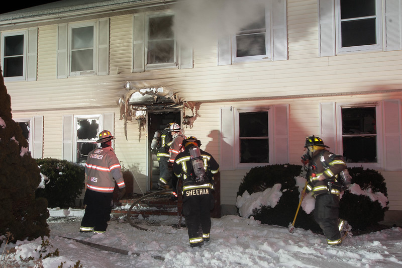 FFs prepare to enter a house on Hy Rd during a 2nd Alm.