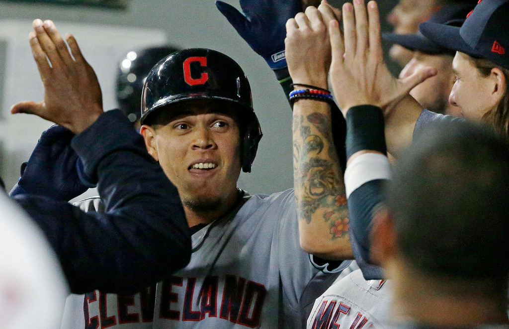 . Cleveland Indians\' Giovanny Urshela is greeted in the dugout after he hit a solo home run during the third inning of a baseball game, Friday, Sept. 22, 2017, in Seattle. (AP Photo/Ted S. Warren)