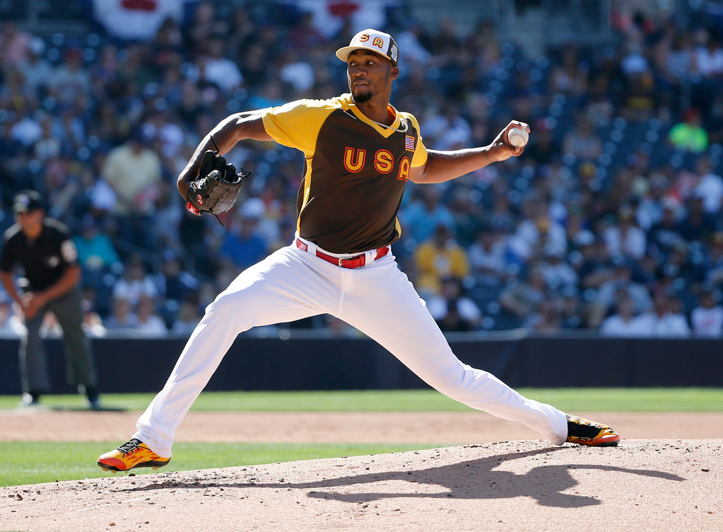 . U.S. Team pitcher Amir Garrett throws against the World Team during the second inning of the All-Star Futures baseball game, Sunday, July 10, 2016, in San Diego. (AP Photo/Lenny Ignelzi)