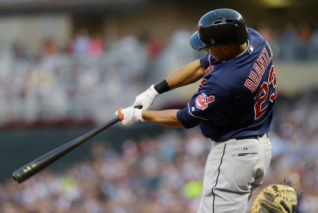 . Cleveland Indians\' Michael Brantley follows through on an RBI single off Minnesota Twins pitcher Samuel Deduno in the fourth inning. (AP Photo/Jim Mone)