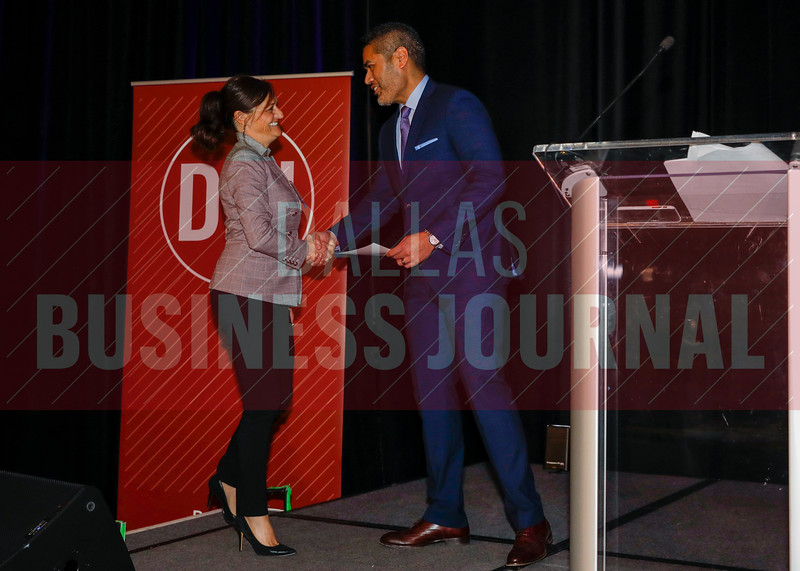 Rose Manjarres, SVP & Head of Information Technology, American Trailer World (left) accepts her Minority Business Leader from Chandhok.