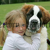 Jessicia McSorley hugs her dog Milly at the pet show during the Markethill festival. 06W32N15