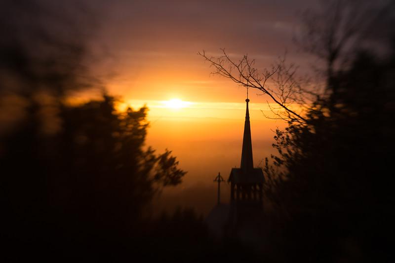 Sunrise behind the spire