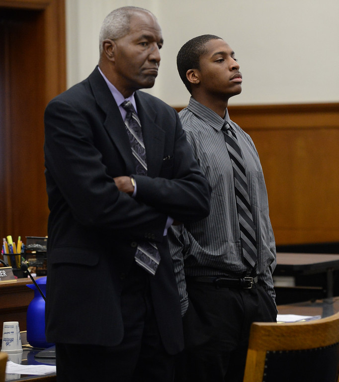 . Defendant Marcelles Peter, right, stands with his attorney Gordon Brown as jurors enter the courtroom at the Wakefield-Taylor courthouse in Martinez, Calif., on Thursday, July 18, 2013. Two separate verdicts were read in the Richmond High gang rape trials Marcelles Peter and Jose Montano with Judge Barbara Zuniga presiding. Juries in both cases brought back guilty verdicts. (Dan Honda/Bay Area News Group)