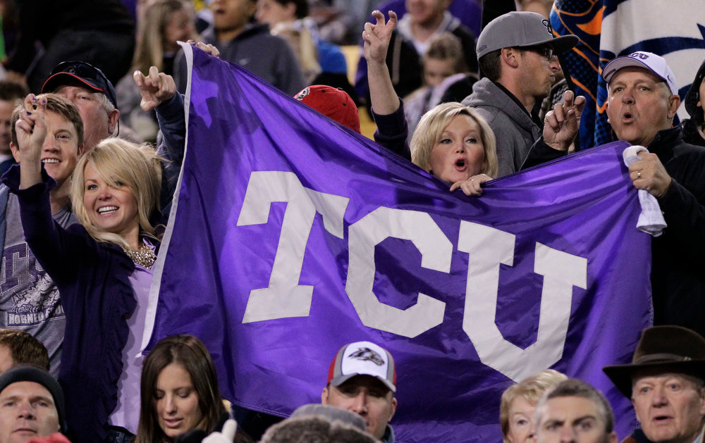 Description of . TCU fans cheer during the first half of the Buffalo Wild Wings Bowl NCAA college football game against Michigan State, Saturday, Dec. 29, 2012, in Tempe, Ariz. (AP Photo/Matt York)