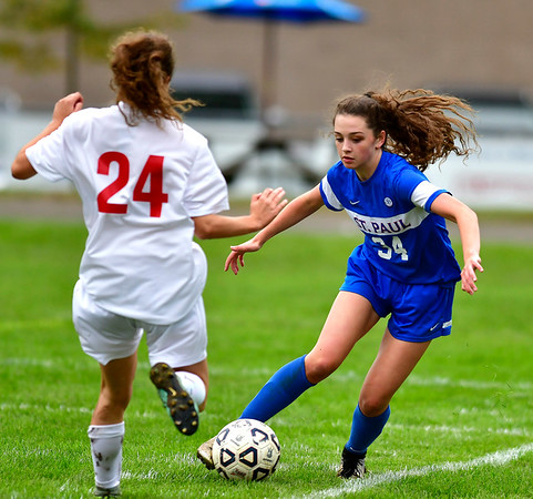10/6/2018 Mike Orazzi | Staff Portland's Olivia Smith (24) and St. Paul Girls Soccer's Hannah Stanford (34) Saturday.