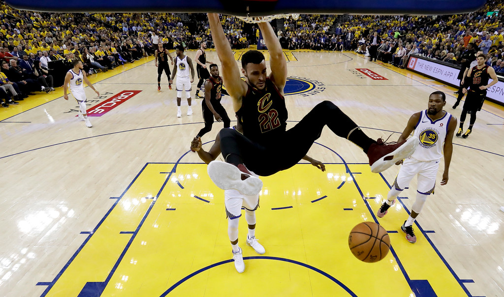 . Cleveland Cavaliers forward Larry Nance Jr. (22) dunks against the Golden State Warriors during the first half of Game 1 of basketball\'s NBA Finals in Oakland, Calif., Thursday, May 31, 2018. (AP Photo/Marcio Jose Sanchez, pool)