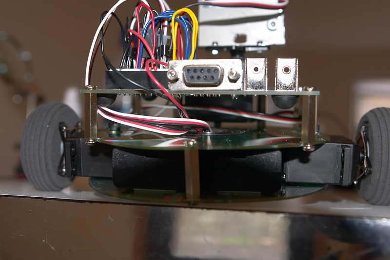 Rear view. CDs conveniently provide a hole in the middle for routing wires between levels