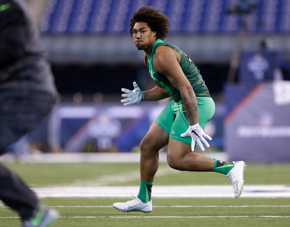 . USC defensive lineman Leonard Williams runs a drill at the NFL football scouting combine in Indianapolis, Sunday, Feb. 22, 2015. (AP Photo/David J. Phillip)
