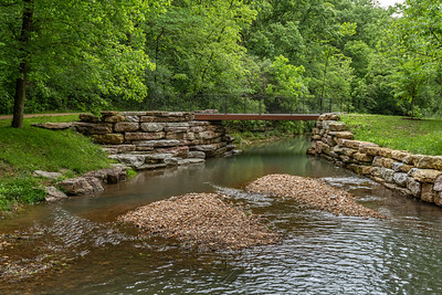 Small footbridge across the stream in canyon park