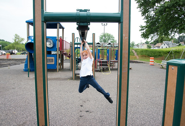 06/05/19 Wesley Bunnell | Staff Izabella Centeno, age 6, works her way down an over head obstacle course on the playground at Chesley Park on Wednesday afternoon.