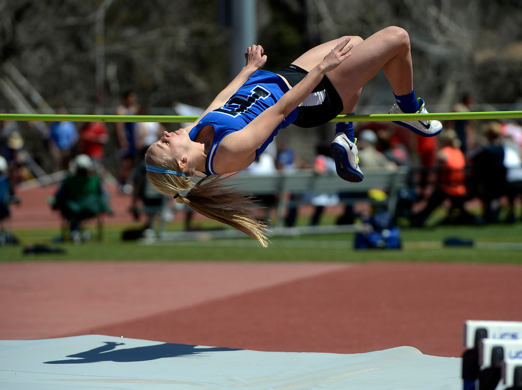 . LITTLETON, CO. - APRIL 27TH: Carly Paul, Poudre High School, clears the bar during the high jump competition at the Liberty Bell Track Meet Saturday afternoon, April 27th, 2013 at the Littleton Public Schools Stadium. (Photo By Andy Cross/The Denver Post)
