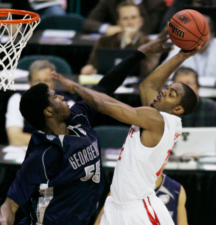 . Ohio State guard Ron Lewis goes up against Georgetown\'s Roy Hibbert (55) during the first half of a Final Four semifinal basketball game at the Georgia Dome in Atlanta, Saturday, March 31, 2007. (AP Photo/Charlie Neibergall)