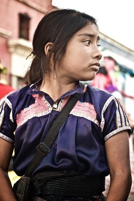 An indigenous Tzotzil girl sells handicrafts on the street in Oaxaca, Mexico.