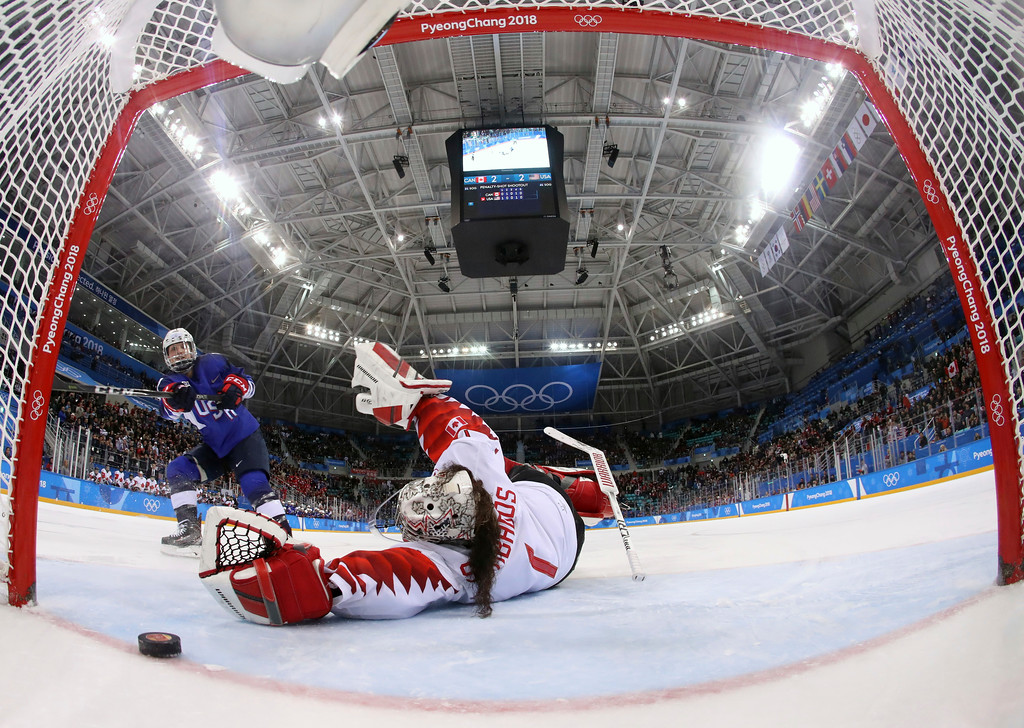 . Jocelyne Lamoureux-Davidson (17), of the United States, scores a game winning goal against goalie Shannon Szabados (1), of Canada, in the penalty shootout during the women\'s gold medal hockey game at the 2018 Winter Olympics in Gangneung, South Korea, Thursday, Feb. 22, 2018. (Bruce Bennett/Pool Photo via AP)