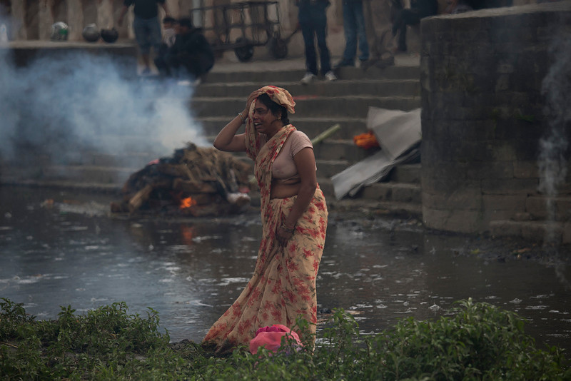 . A woman weeps during the cremation of a victim of Saturdayís earthquake, at the Pashupatinath temple, on the banks of Bagmati river, in Kathmandu, Nepal, Sunday, April 26, 2015. The earthquake centered outside Kathmandu, the capital, was the worst to hit the South Asian nation in over 80 years. It destroyed swaths of the oldest neighborhoods of Kathmandu, and was strong enough to be felt all across parts of India, Bangladesh, China\'s region of Tibet and Pakistan. (AP Photo/Bernat Armangue)