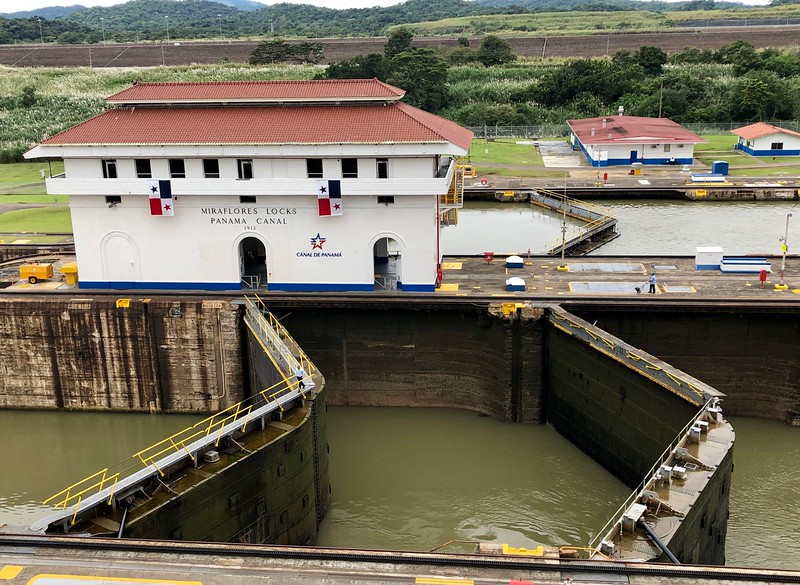 Miraflores Locks building sitting next to locks in the Panama Canal.