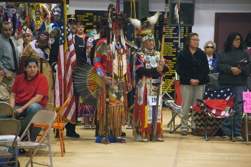 Havre Daily News/Floyd Brandt     (Left) Milton Madson and Ronald Windy Boy lead the Grand Entry carrying Eagle Staffs Friday  April 01, 2017 Havre, Montana