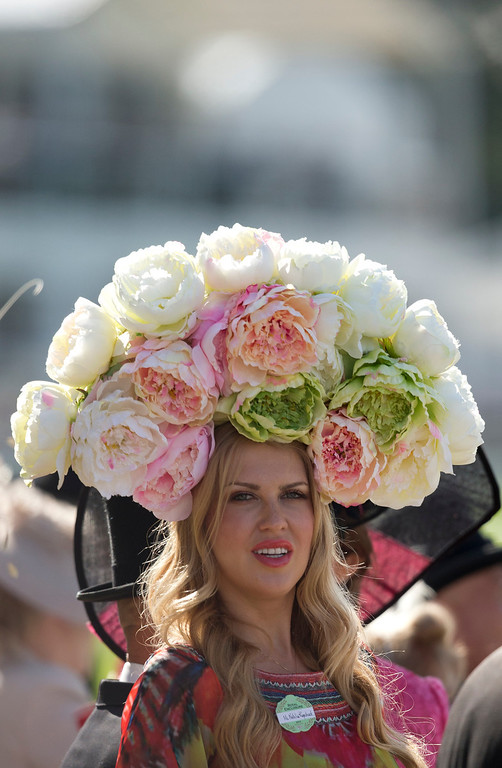 . Natalie Kapchuck wears a floral hat on the second day of the Royal Ascot horse racing meeting at Ascot, England, Wednesday, June, 18, 2014.  (AP Photo/Alastair Grant)