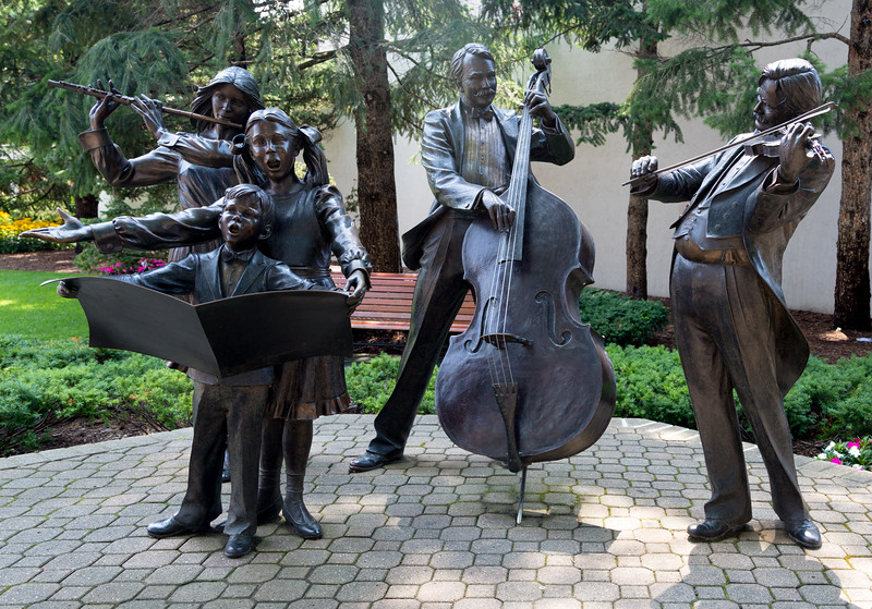 Wonderful sculpture of a trio with two young singers