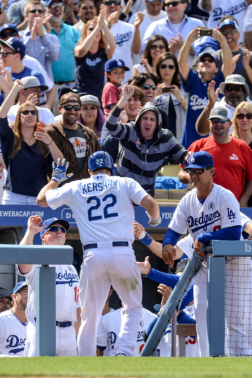 . Dodger\'s Clayton Kershaw is congratulated after hitting a home run in the 8th inning during opening day at Dodger Stadium Monday.  Dodgers defeated the Giants 4-0.  Photo by David Crane/Los Angeles Daily News.