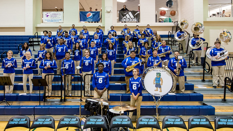 The Islander Pep Band poses for a group photo before they perform for the Island Invasion event.