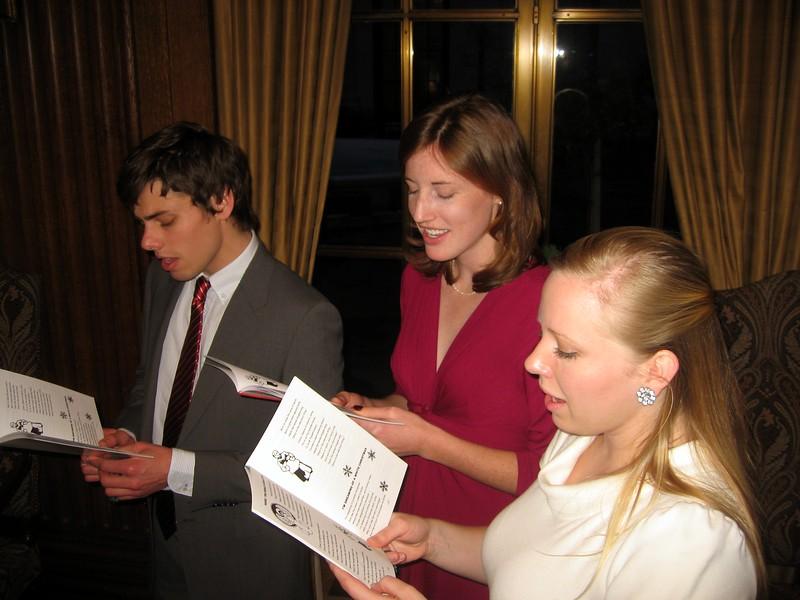 JP (l), Kristin, and Katharine sing Christmas carols
