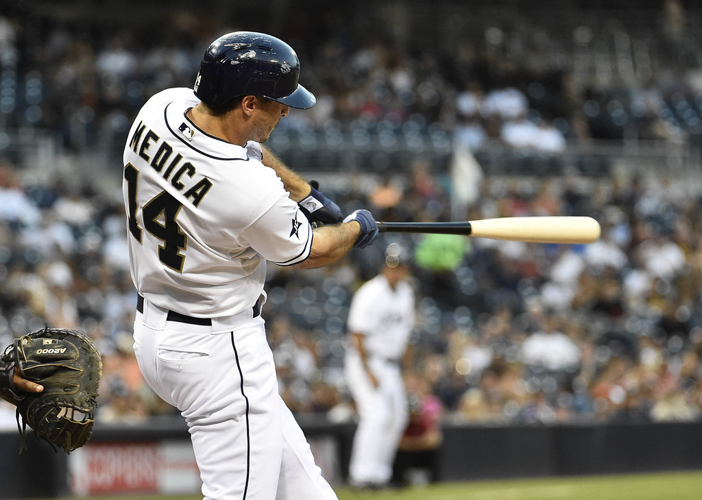 . SAN DIEGO, CA - SEPTEMBER 24:  Tommy Medica #14 of the San Diego Padres hits a three-run home run during the first inning of a baseball game against the Colorado Rockies at Petco Park September, 24, 2014 in San Diego, California.  (Photo by Denis Poroy/Getty Images)