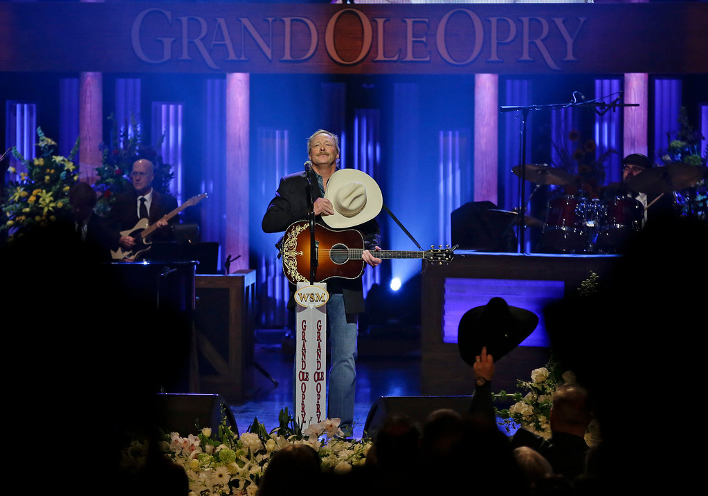 """. Alan Jackson is cheered after performing \""""He Stopped Loving Her Today\"""" to close the funeral for country music star George Jones in the Grand Ole Opry House on Thursday, May 2, 2013, in Nashville, Tenn. Jones, one of country music\'s biggest stars who had No. 1 hits in four separate decades, died April 26.  (AP Photo/Mark Humphrey, Pool)"""