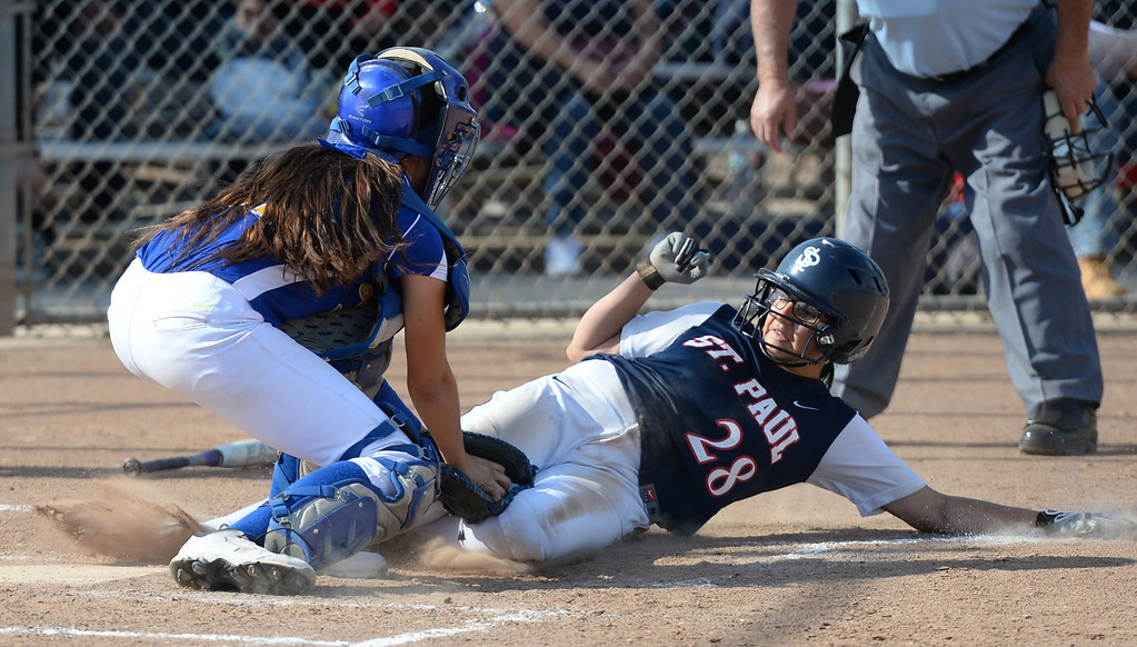. St. Paul\'s Samantha Rivas (#28) is tagged out by Bishop Amat catcher Julia Valenzuela (#32) at home plate in their Del Rey League girls softball game at York Field in Whittier on Thursday March 27, 2014. St. Paul defeated Bishop Amat 7-5. (Staff Photo by Keith Durflinger/Whittier Daily News)