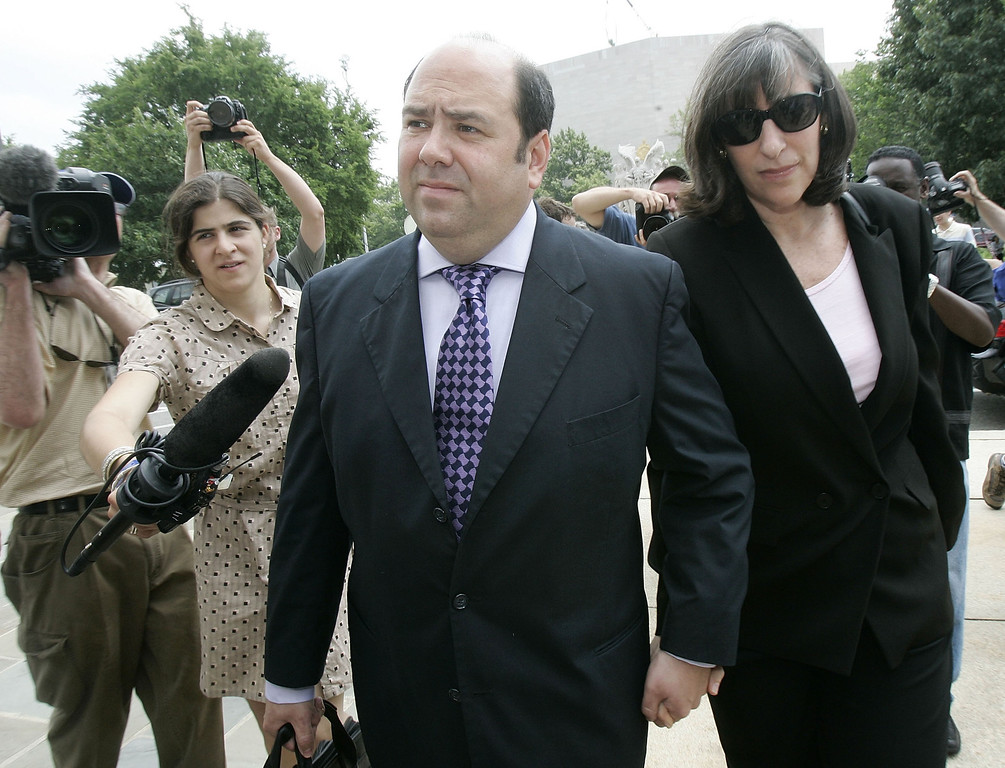 . WASHINGTON - JULY 06:  Reporter Matt Cooper (2nd R) of Time magazine arrives at a U.S. district court with an unidentified woman July 6, 2005 in Washington, DC. Cooper and Judith Miller of the News York Times face jail time if they still refuse to identify their source of a leak on the identity of covert CIA operative Valerie Plame. Cooper has agreed to testify in front of the grand jury investigating the leak.   (Photo by Alex Wong/Getty Images)