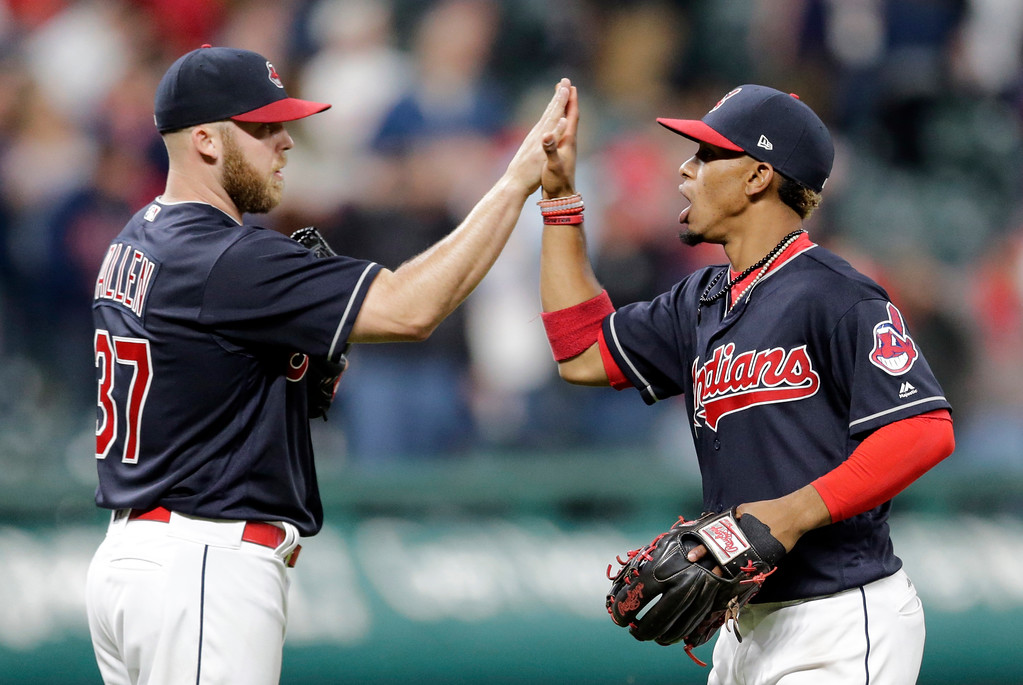 . Cleveland Indians\' Francisco Lindor, right, celebrates with relief pitcher Cody Allen after the Indians defeated the Tampa Bay Rays 8-7 in a baseball game, Monday, May 15, 2017, in Cleveland. (AP Photo/Tony Dejak)
