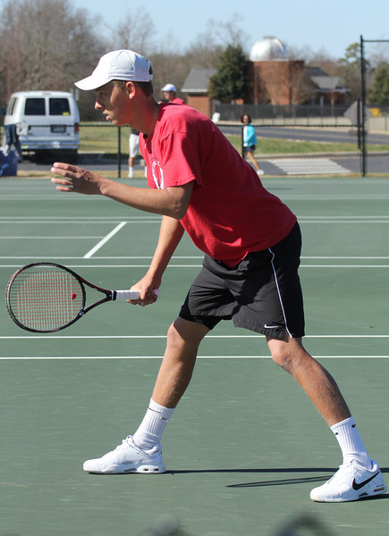 Adam Knutsson-Sunblad plays tennis against the Trojans of Anderson University.