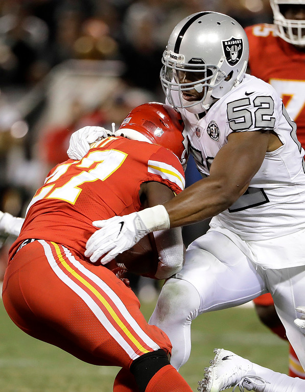 . Oakland Raiders defensive end Khalil Mack (52) tackles Kansas City Chiefs running back Kareem Hunt (27) during the second half of an NFL football game in Oakland, Calif., Thursday, Oct. 19, 2017. (AP Photo/Marcio Jose Sanchez)