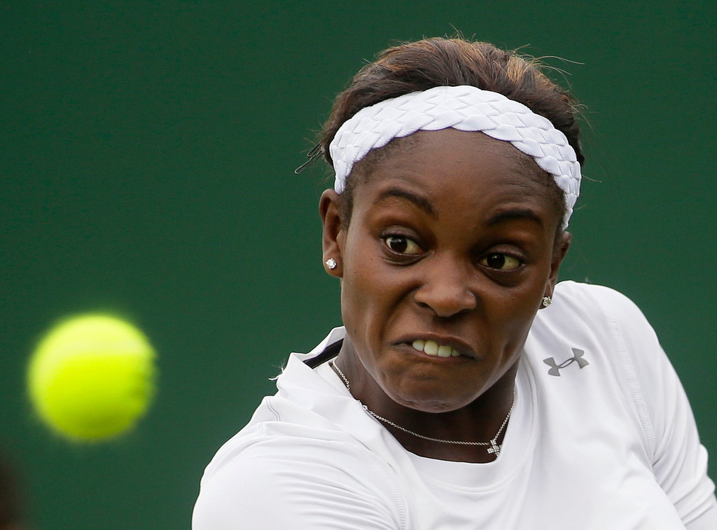 . Sloane Stephens of the United States returns the ball to Jamie Hampton of the United States during their Women\'s first round singles match at the All England Lawn Tennis Championships in Wimbledon, London, Monday, June 24, 2013.  (AP Photo/Alastair Grant)