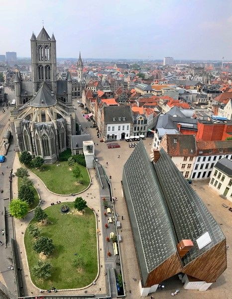 St. Nicholas church, dating back to the 13th century, alongside the modern Stadshal (City Pavillion), built in 2012 - Ghent, Belgium